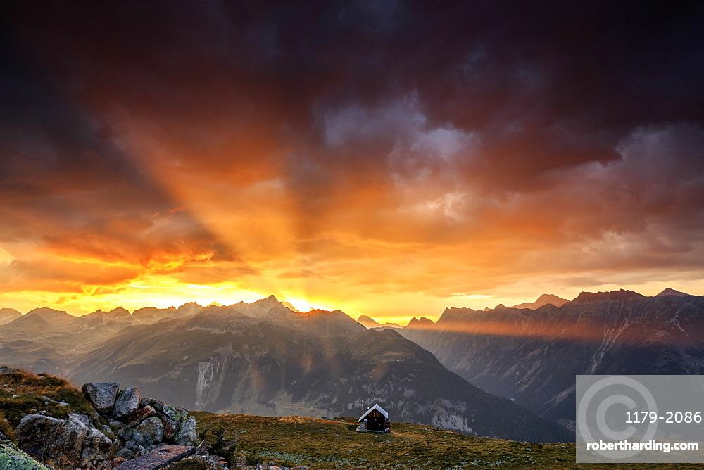 Rays of sun of fiery sky at sunset above the peaks, Muottas Muragl, St. Moritz, Canton of Graubunden, Engadine, Switzerland, Europe