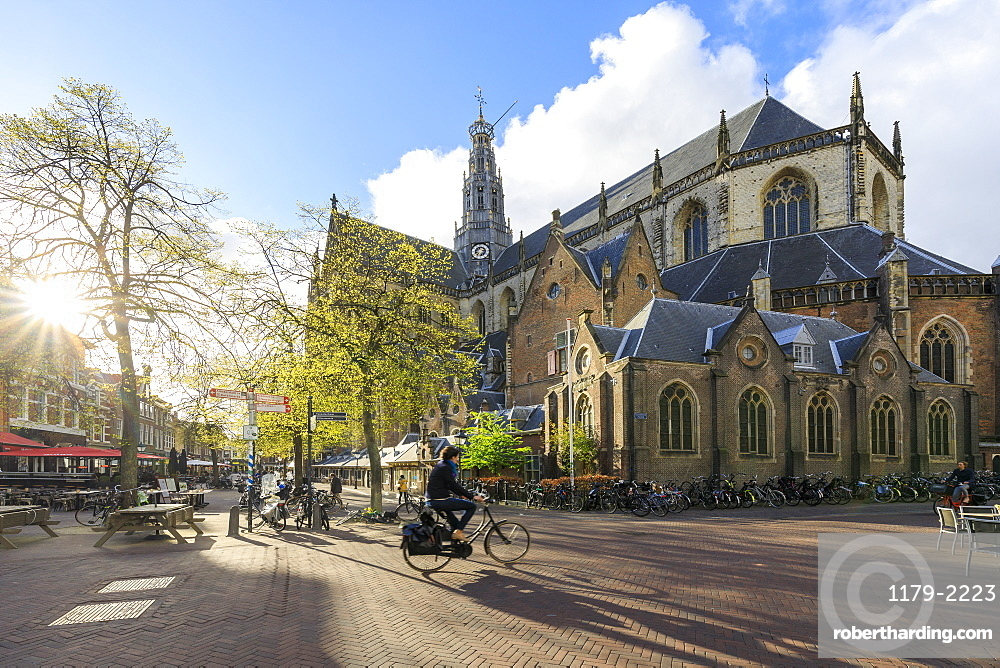 Bicycles in the pedestrian square next to the ancient church Grote Kerk, Haarlem, North Holland, The Netherlands, Europe