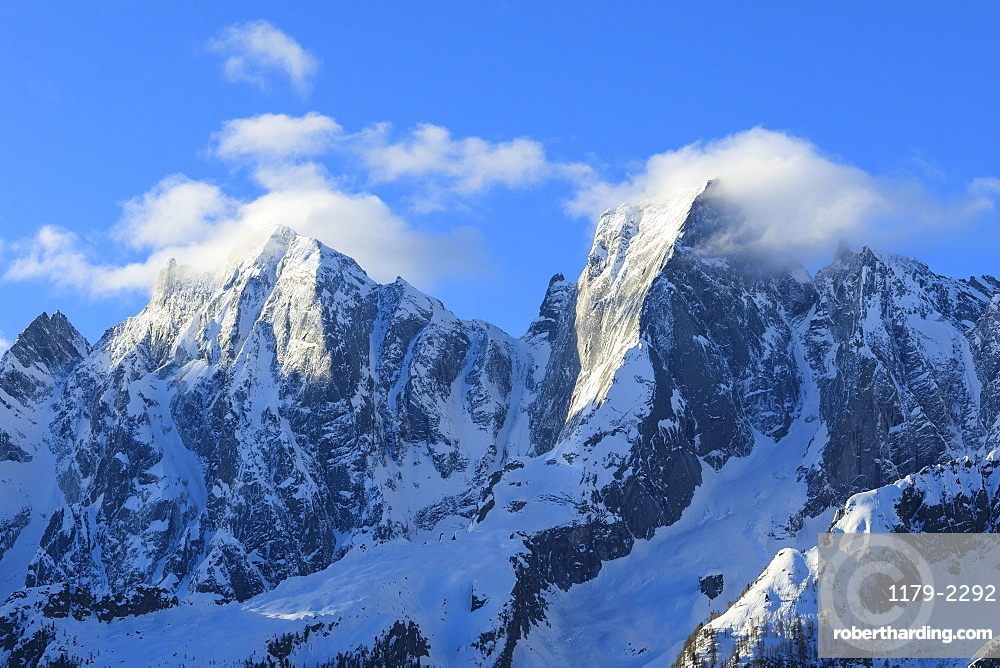 Rocky peaks Badile and Cengalo covered with snow in spring, Soglio, Bregaglia Valley, canton of Graubunden, Switzerland, Europe