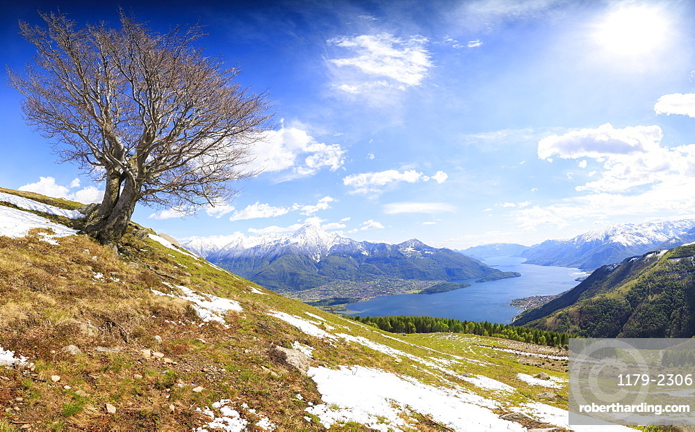 Panorama of meadows partially covered with snow with Lake Como on the background, Montemezzo, Alpe Zocca, Lombardy, Italian Lakes, Italy, Europe