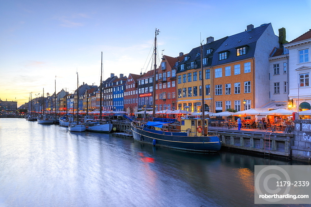 Blue lights of dusk on harbour and canal of the entertainment district of Nyhavn, Copenhagen, Denmark, Europe