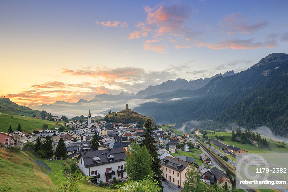 Pink clouds at dawn on the alpine village of Ardez, canton of Graub?nden, district of Inn, lower Engadine, Switzerland, Europe