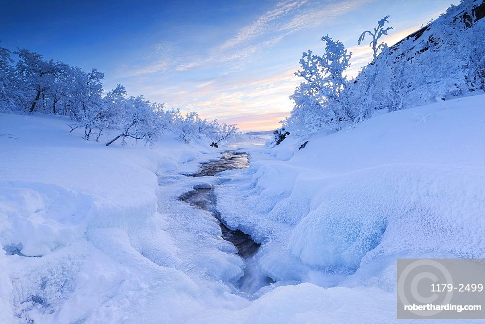 Sunrise on the frozen river and forest, Abisko, Kiruna Municipality, Norrbotten County, Lapland, Sweden, Scandinavia, Europe