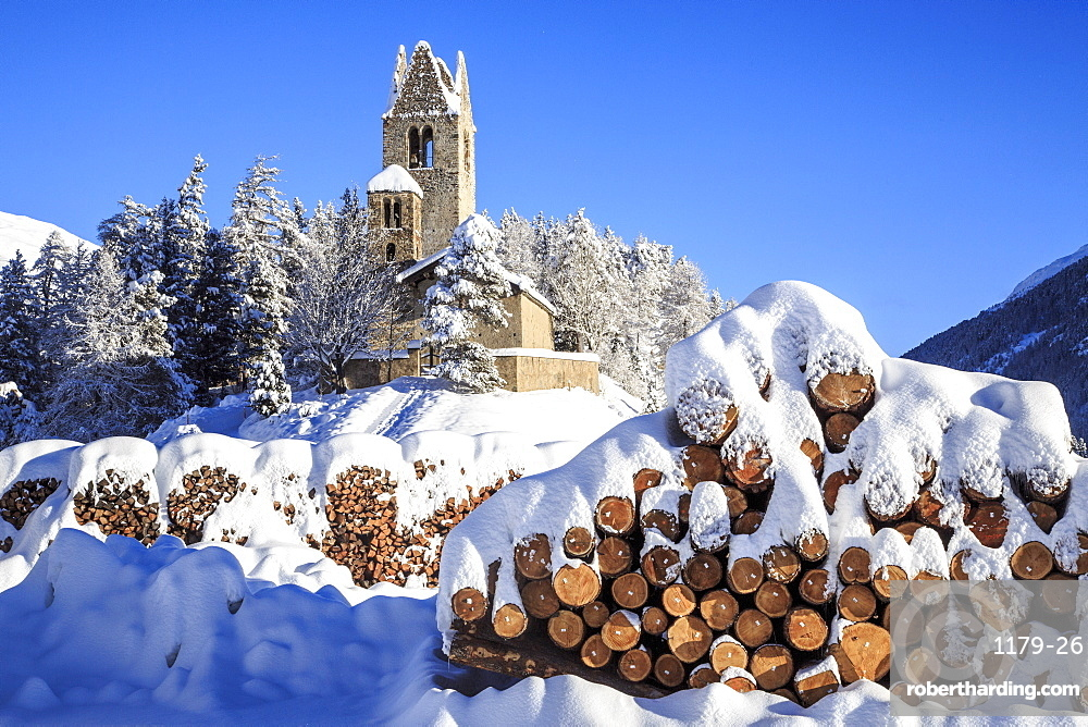 Saint Gian Church after a snowfall in Engadine, Switzerland, Europe