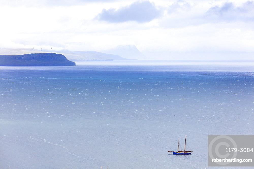 Isolated boat in the ocean during the historical regatta, Torshavn, Streymoy Island, Faroe Islands, Denmark, Europe