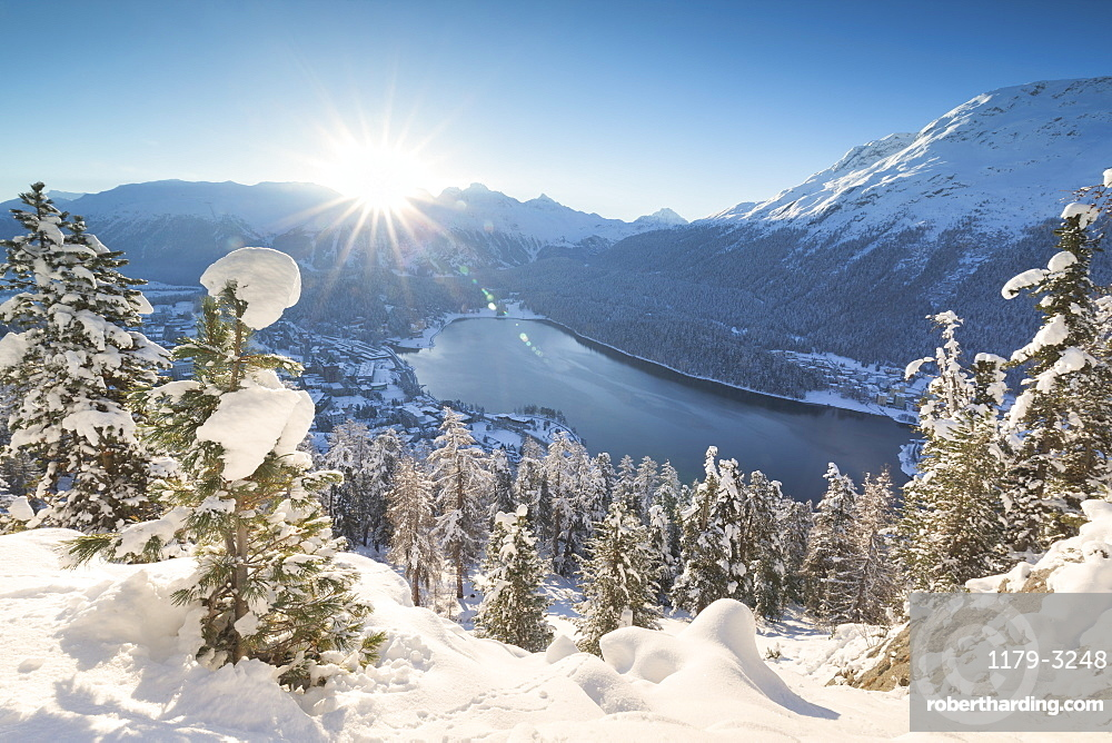 Sunrise over village and Lake of St. Moritz covered with snow, Engadine, Canton of Graubunden, Switzerland, Europe