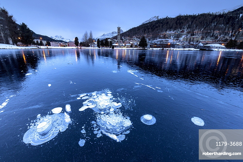 Ice bubbles trapped in the frozen Lake St. Moritz, Engadine, Canton of Graubunden, Switzerland, Europe