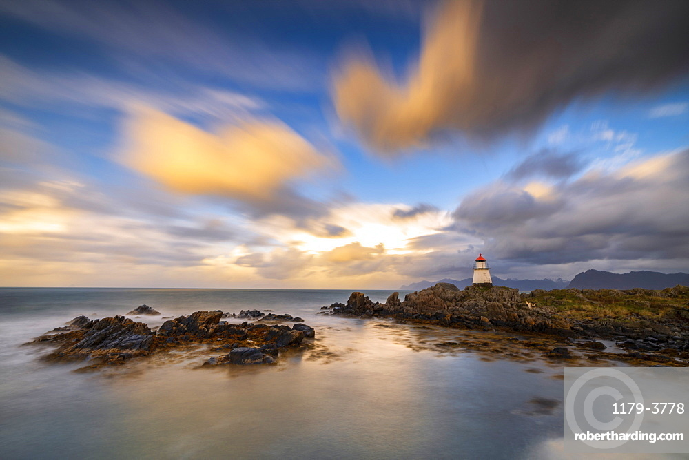 Lighthouse at sunset in Hovsund, Lofoten Islands, Norway, Europe
