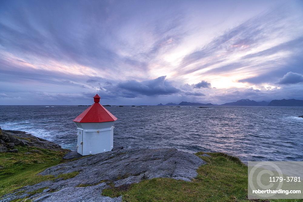 Lighthouse at sunset in Henningsvaer, Lofoten Islands, Norway, Europe