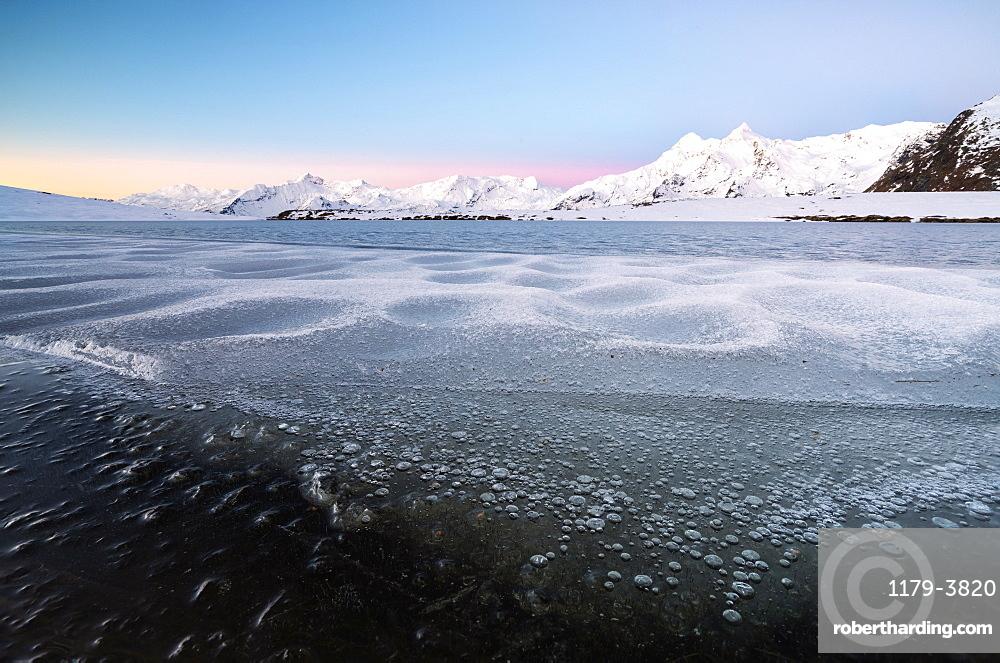 Frozen Lake Andossi in Spluga Valley, Italy, Europe