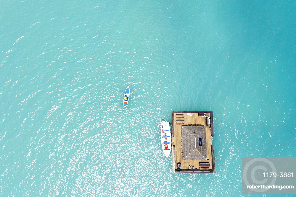 Aerial view by drone of man on paddleboard approaching the floating Ocean Bar, Caribbean, Antilles, West Indies, Caribbean, Central America