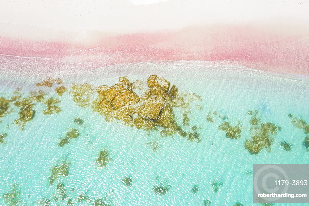 Waves of turquoise sea crashing into pink sand beach from drone above, Caribbean, Antilles, West Indies, Caribbean, Central America