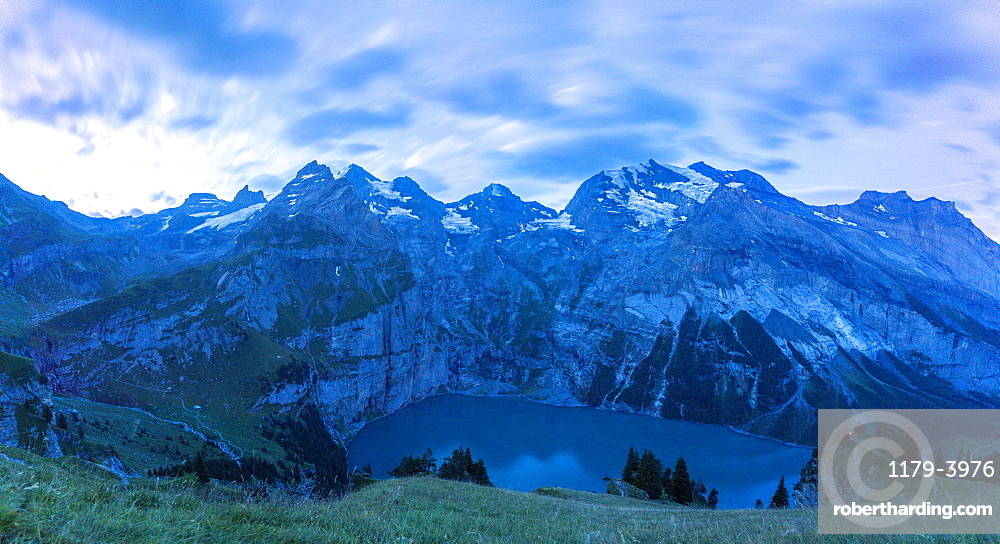 Clouds at dusk over Oeschinensee lake, Bernese Oberland, Kandersteg, Canton of Bern, Switzerland, Europe