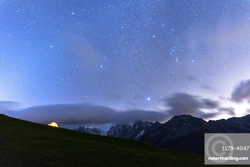 Camping tent under the stars facing Piz Badile and Piz Cengalo, Tombal, Soglio, Val Bregaglia, canton Graubunden, Switzerland