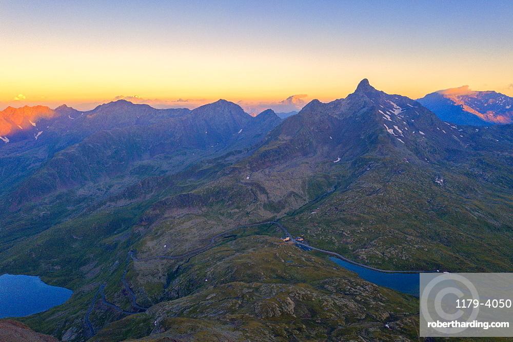 Aerial view of the sky at sunrise over the rocky peaks at Gavia Pass, Valfurva, Valtellina, Sondrio province, Lombardy, Italy