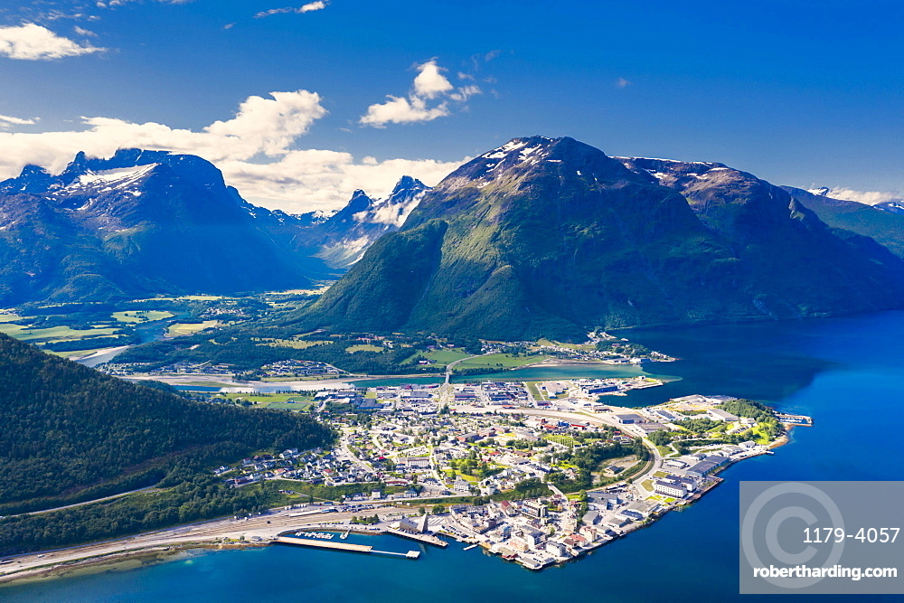 Aerial view of mountains and fjord surrounding Andalsnes town, Rauma municipality, More og Romsdal county, Norway (drone)