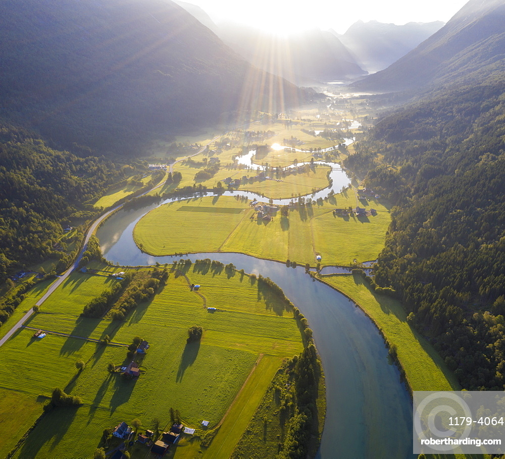 Aerial panoramic of Stryneelva river and fields during a misty sunrise, Stryn, Nordfjorden, Sogn og Fjordane county, Norway