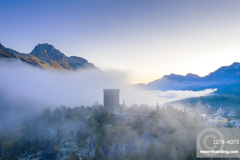 Aerial view of mist over Torre Belvedere in autumn, Maloja Pass, Engadin, canton of Graubunden, Switzerland (drone)