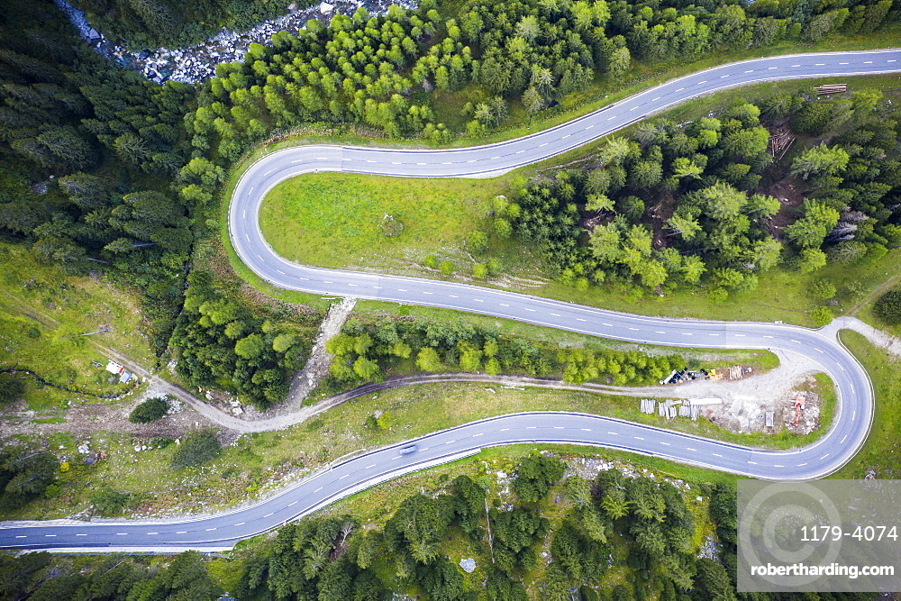 Hairpin curve of S-shape road at Maloja Pass from above, Val Bregaglia, canton of Graubunden, Engadin, Switzerland (drone)