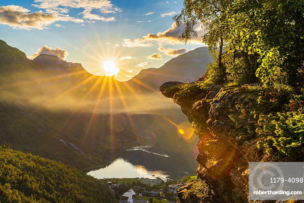Last rays of sunset over Geiranger village and Geirangerfjord, UNESCO World Heritage Site, Stranda municipality, More og Romsdal, Norway, Scandinavia, Europe