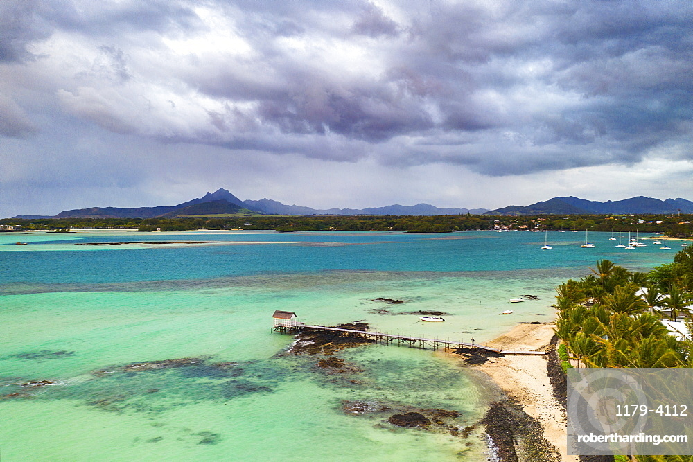 Clouds over lagoon and pier by a palm fringed beach, aerial view, Trou d'Eau Douce, Flacq, East coast, Mauritius, Indian Ocean, Africa