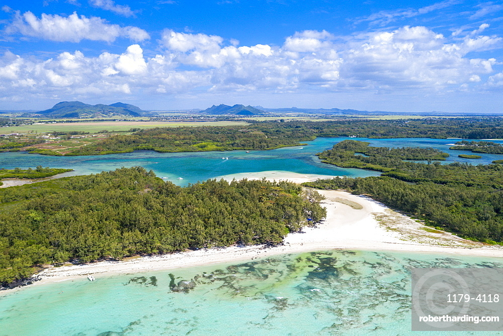 Aerial by drone of white sand beach with turquoise sea surrounded by tropical trees, Ile Aux Cerfs, Flacq, Mauritius, Indian Ocean, Africa