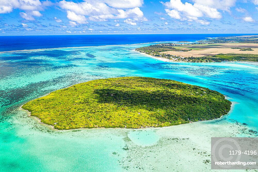 Lush vegetation on Ile aux Aigrettes atoll in the turquoise lagoon, aerial view by drone, Pointe d'Esny, Mahebourg, Mauritius, Indian Ocean, Africa