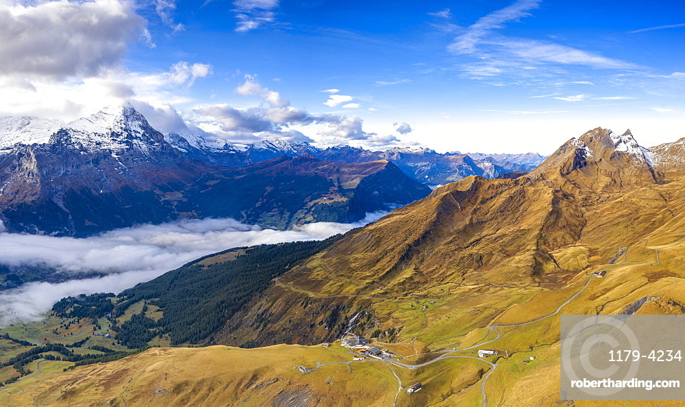 Aerial panoramic of Eiger and sea of clouds surrounding First and Grindelwald in autumn, Canton of Bern, Switzerland
