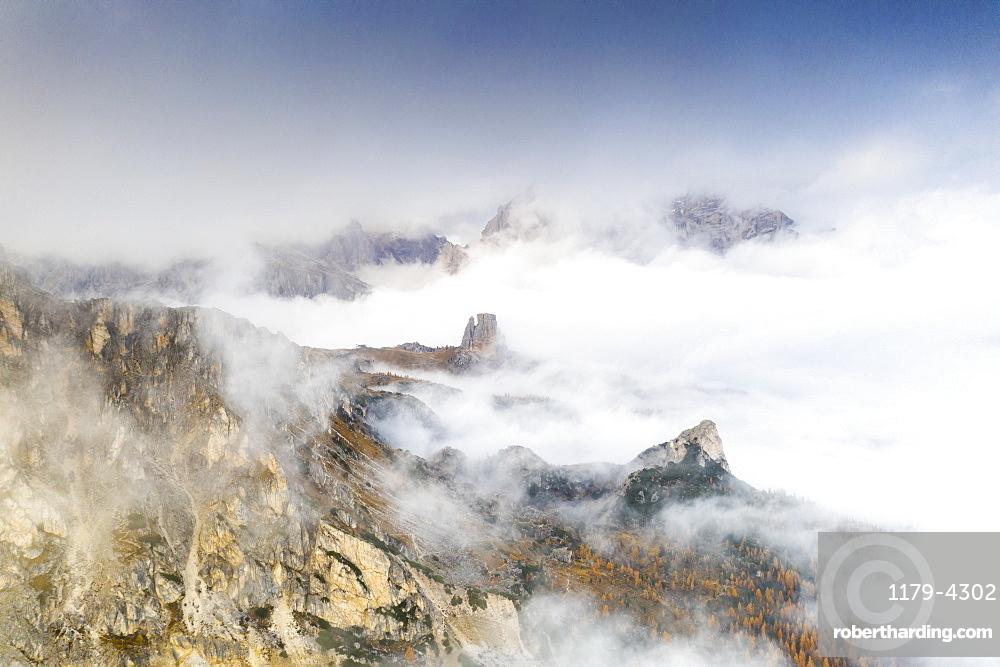 Aerial view of autumn mist over the trees and woods surrounding Cinque Torri and Tofane, Giau Pass, Dolomites, Belluno, Veneto, Italy, Europe
