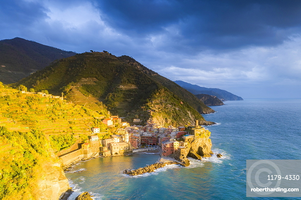 Clouds at sunset over the coastal village of Vernazza, aerial view, La Spezia province, Liguria, Italy