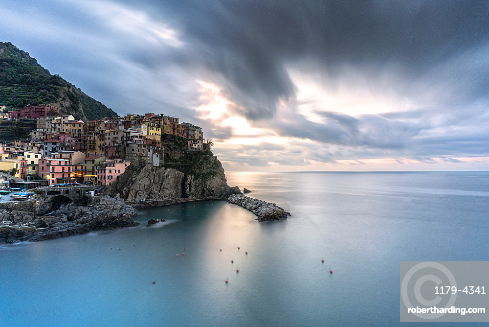 Storm clouds at sunrise over Manarola and Ligurian Sea, Cinque Terre, La Spezia province, Liguria, Italy