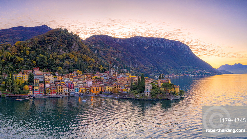 Autumn sunrise over Varenna old town on shores of Lake Como, aerial view, Lecco province, Lombardy, Italy