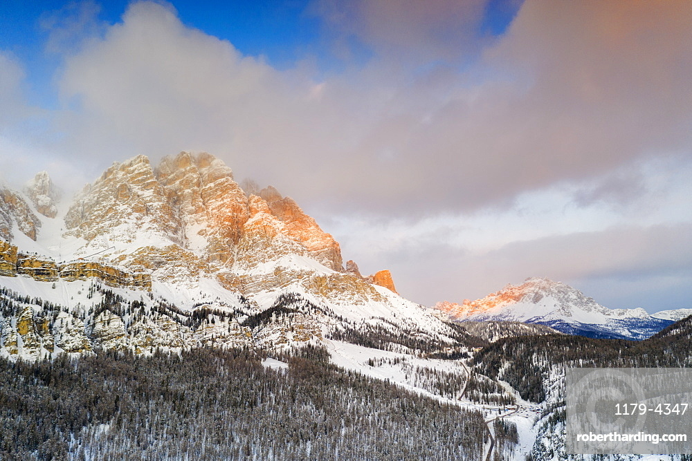Sunrise over Monte Cristallo and Passo Tre Croci surrounded by snowy woods, Dolomites, Belluno province, Veneto, Italy