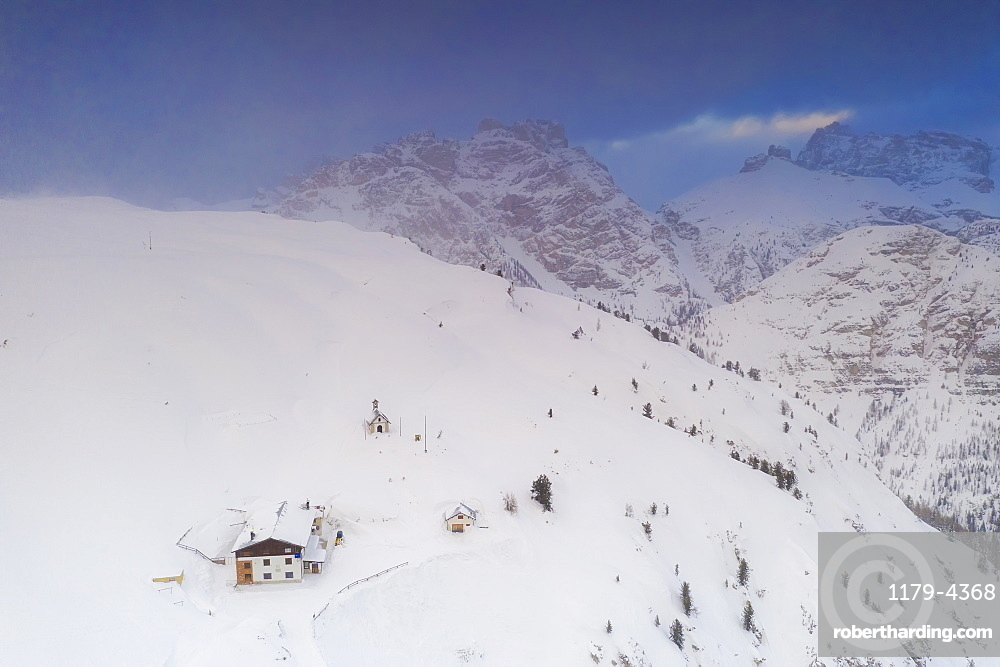 Rifugio Bosi hut on top of Monte Piana covered with snow, Dolomites, Auronzo di Cadore, Belluno, Veneto, Italy (drone)