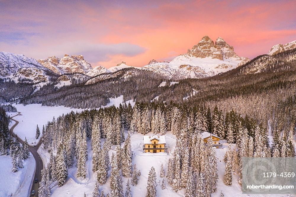 Tre Cime di Lavaredo and woods covered with snow during a winter sunset, Misurina, Dolomites, Belluno province, Veneto, Italy