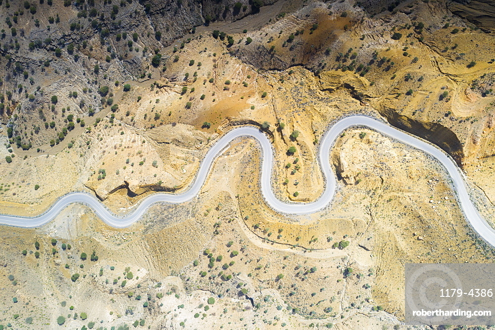 Aerial view by drone of hairpin bends of empty road along Danakil desert from above, Afar Region, Ethiopia, Africa