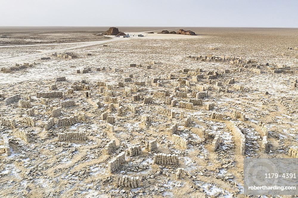 Blocks of salt extracted by miners in the Ahmed Ela Salt Plain, Dallol, Danakil Depression, Afar Region, Ethiopia, Africa