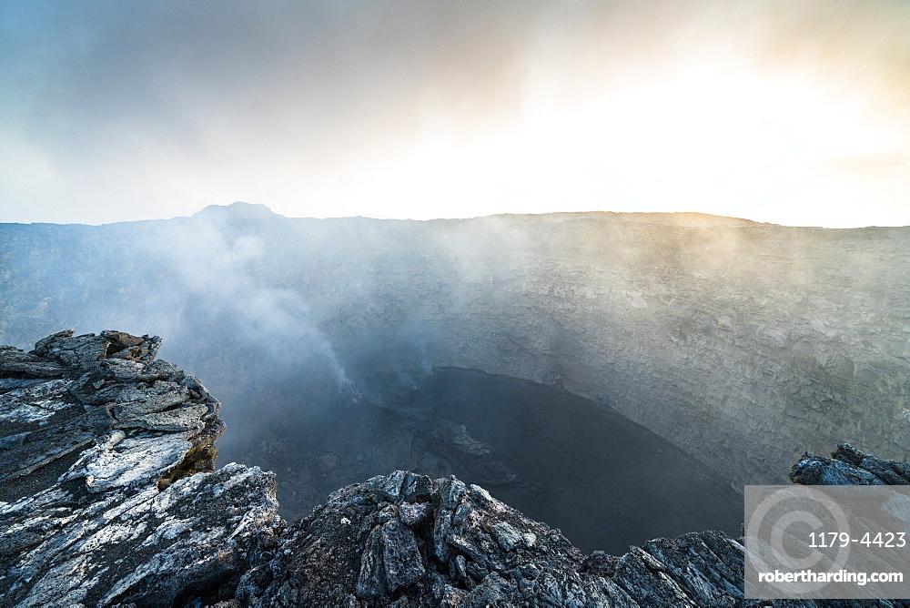 Smoke emission out of Erta Ale volcano caldera, Danakil Depression, Afar Region, Ethiopia, Africa