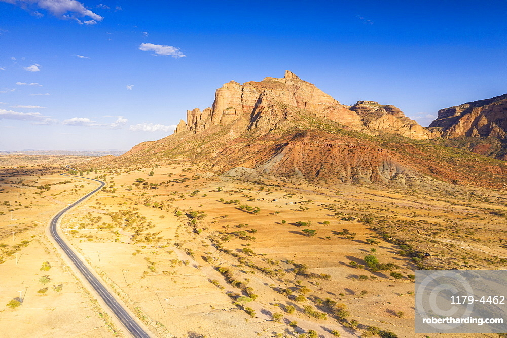 Road crossing the desert landscape of Gheralta Mountains at sunset, aerial view, Hawzen, Tigray Region, Ethiopia, Africa (drone)