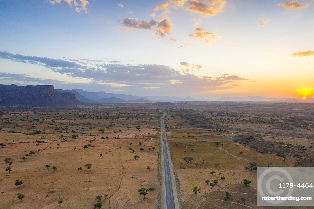 Empty road across the arid landscape, aerial view, Gheralta Mountains, Hawzen, Tigray Region, Ethiopia, Africa (drone)
