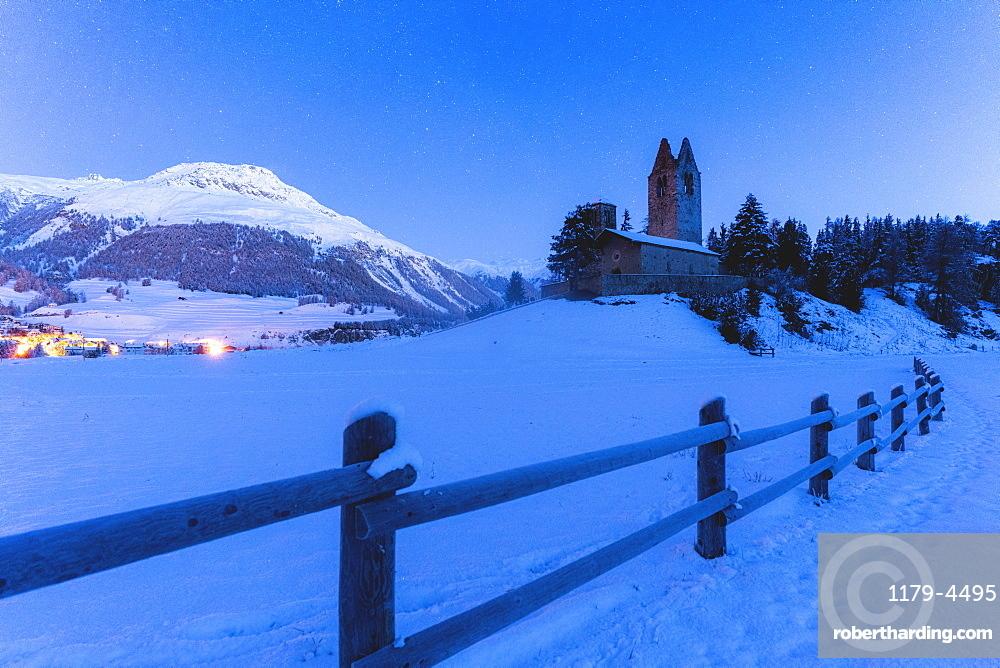 Church of San Gian with the snowy peaks in background, Celerina, St. Moritz, canton of Graubunden, Engadine, Switzerland