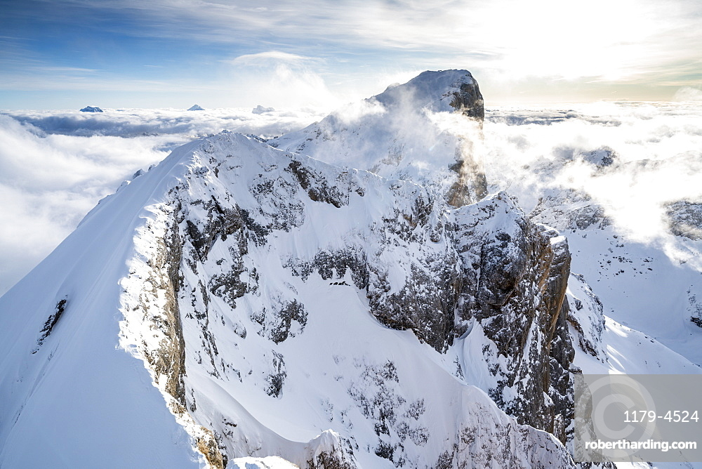 Aerial view of Punta Penia and west ridge of Marmolada covered with snow, Dolomites, Trentino-Alto Adige, Italy