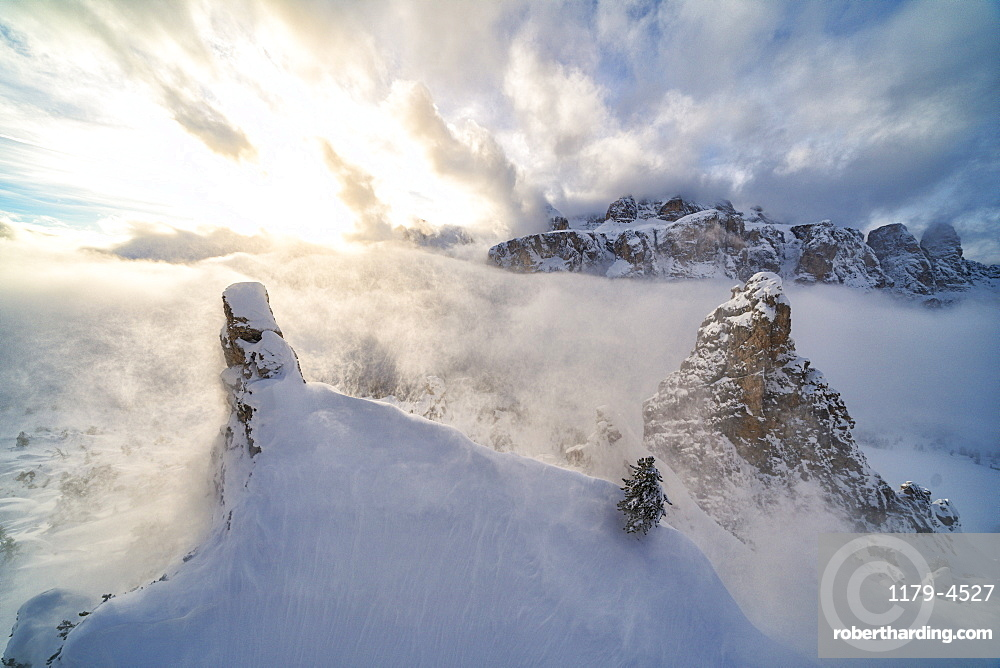 Aerial view of Sella covered with snow from Cir group, Puez-Odle Nature Park, Gardena Pass, Dolomites, South Tyrol, Italy