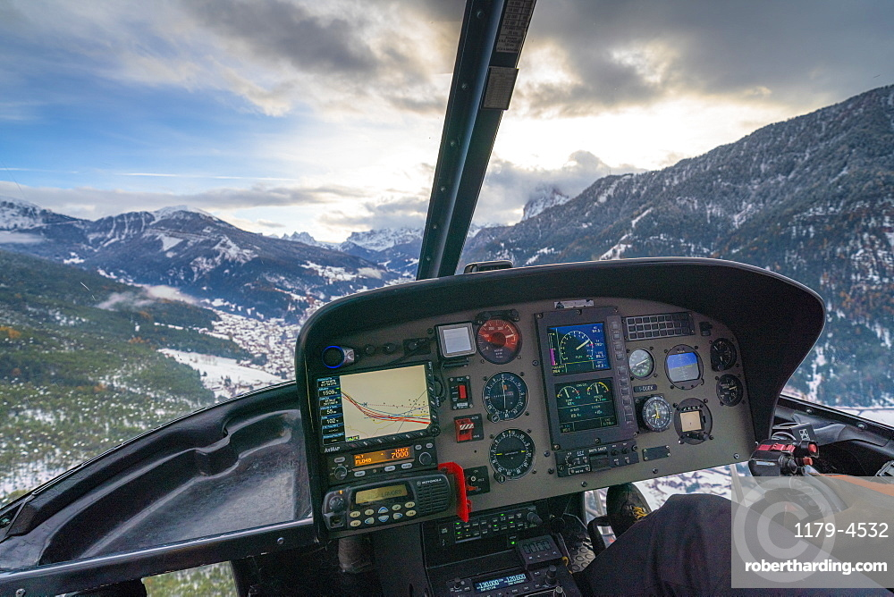 Cockpit of helicopter flying over the Dolomites, Trentino-Alto Adige, Italy