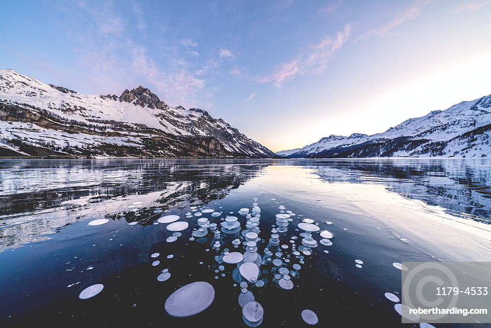 Ice bubbles trapped in Lake Sils with Piz Lagrev in background, canton of Graubunden, Engadine, Switzerland
