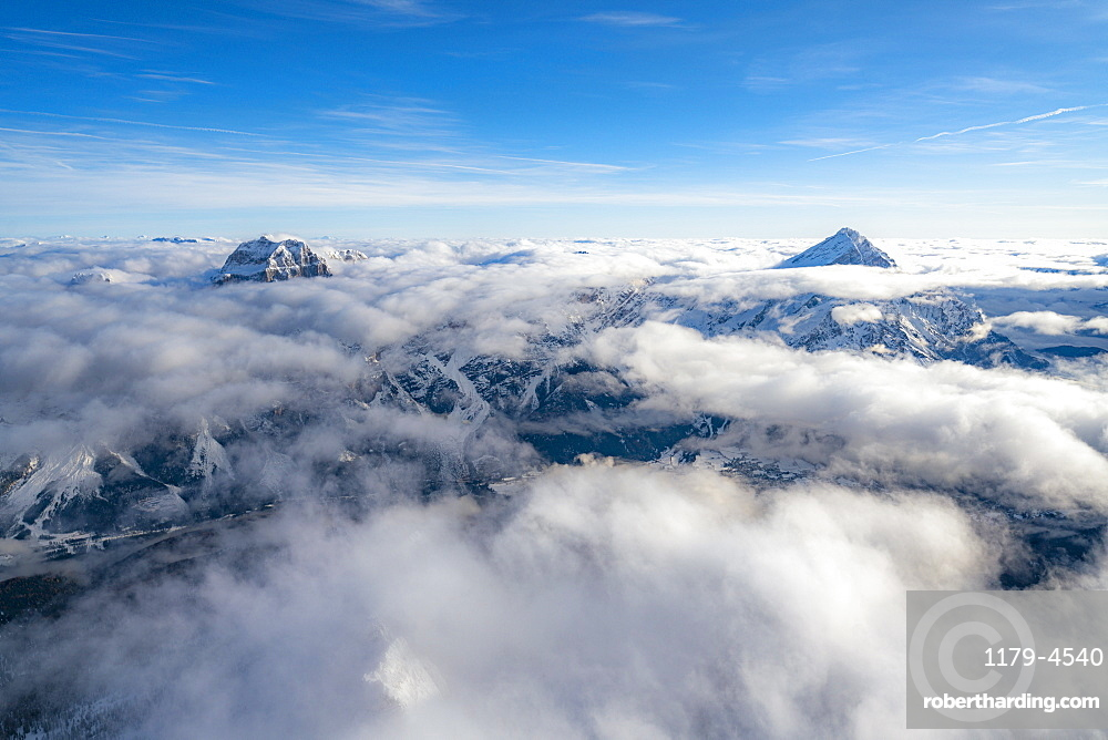 Sorapis group and Antelao emerging from clouds, aerial view, Dolomites, Belluno province, Veneto, Italy