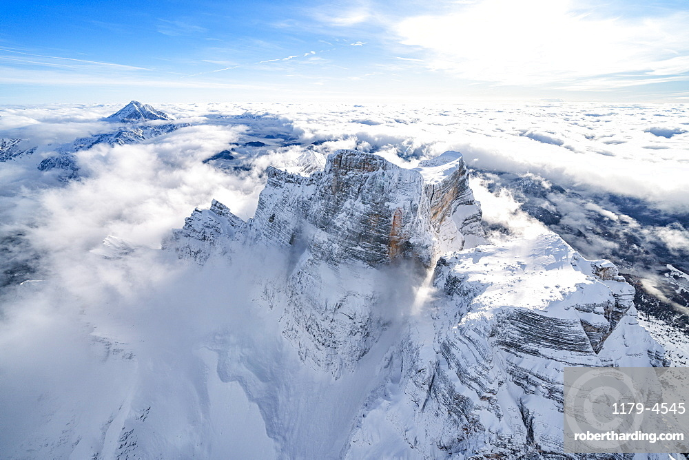 Snow capped Monte Pelmo emerging from clouds, aerial view, Dolomites, Belluno province, Veneto, Italy