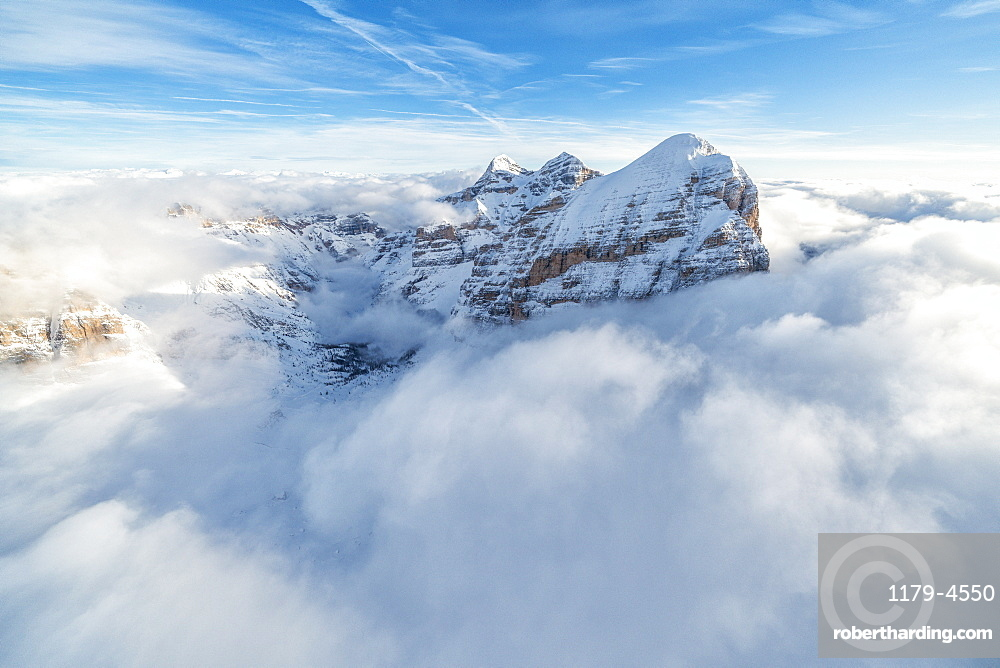 Aerial view of the snow capped Tofane group in a sea of clouds, Dolomites, Belluno province, Veneto, Italy