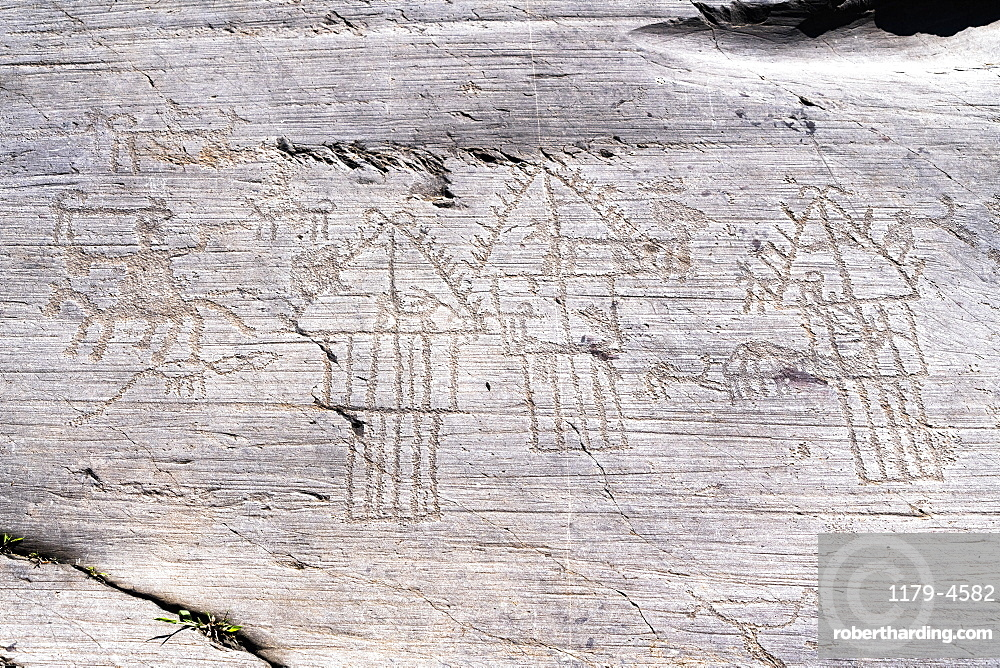 Camunian village with hut and barns or pantries engraved on rock 35, Naquane National Park, Valcamonica (Val Camonica), Lombardy, Italy, Europe