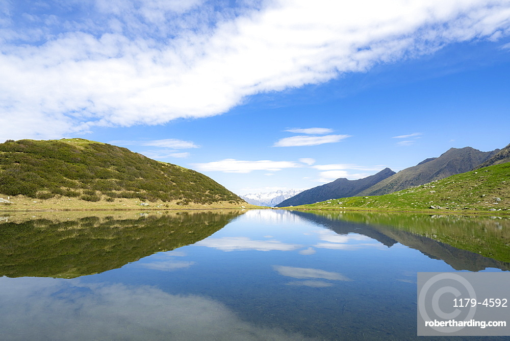 Mountains reflected in the blue water of Porcile Lakes, Tartano Valley, Valtellina, Sondrio province, Lombardy, Italy